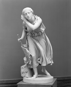 """a black and white photograph of the sculpture """"Nydia, the Blind Flower Girl of Pompeii"""" by Randolph Rogers, at the Metropolitan Museum of Art"""
