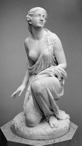 """a black and white photograph of the sculpture """"Ruth Gleaning"""" by Randolph Rogers, at the Metropolitan Museum of Art"""