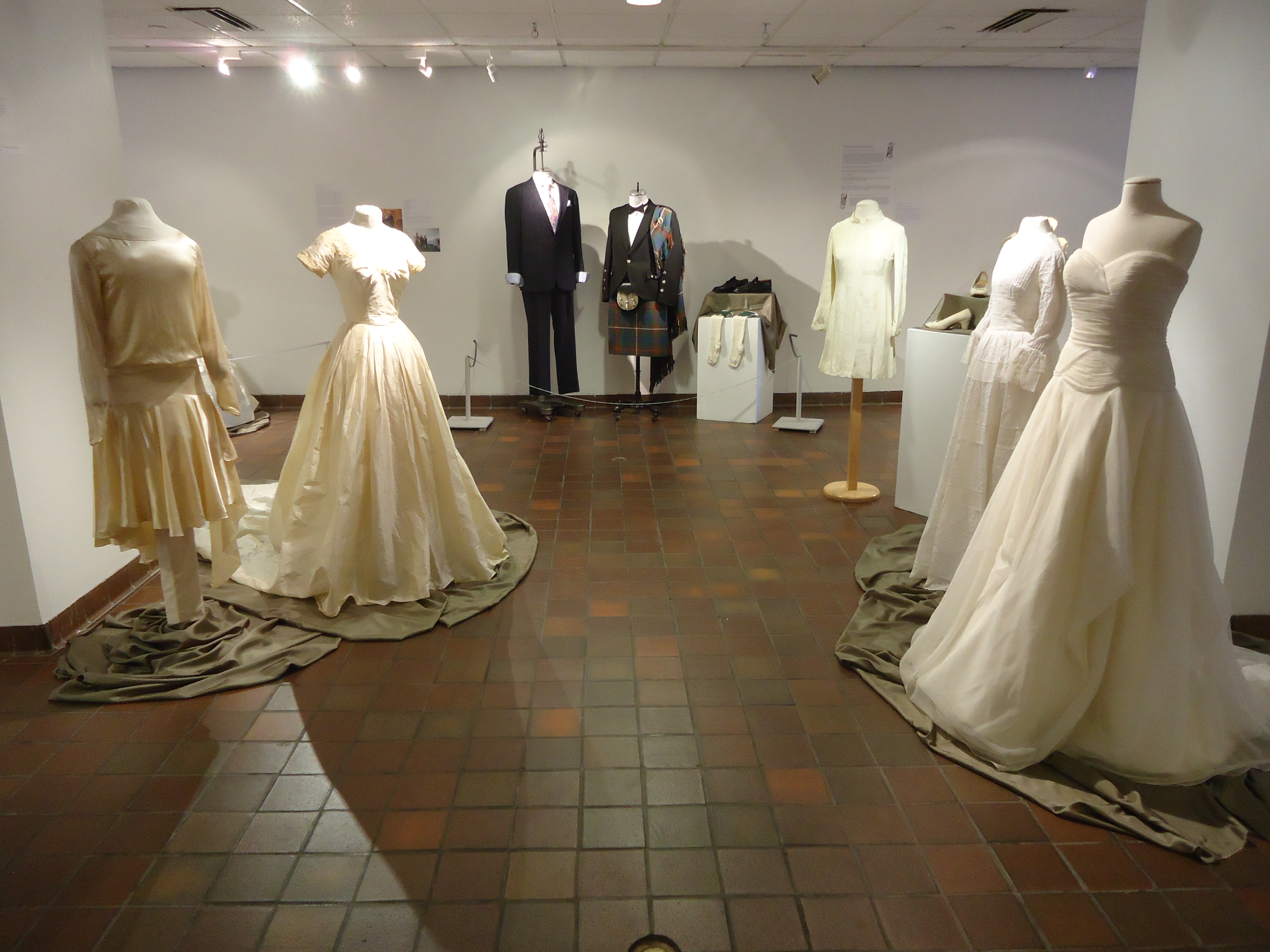 an image of 5 very different wedding dresses and 2 groom's outfits